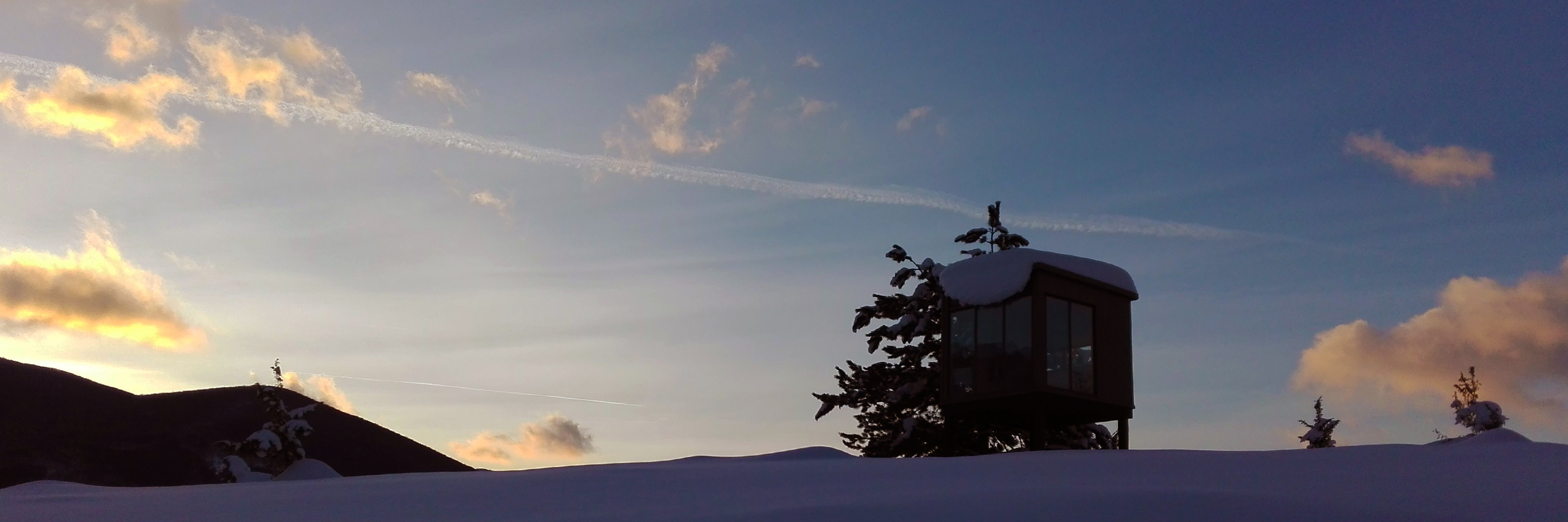 neve al PineCube durante ciaspolata al tramonto